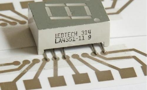 A seven-segment display connected to paper circuit by conductive tape.