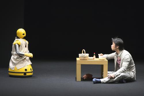 A scene from 'I, Worker,' one of two plays being presented by the Wexner Center for the Arts earlier this year that featured both human and robot actors. The plays were the result of a collaboration between Japan's Seinendan Theater Company and robotics researchers at Osaka University.   (Source: Wexner Center for the Arts)