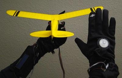 Control the flight of a remote control airplane through the sensors in a glove.