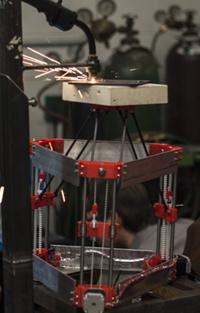 You can build a low-cost open-source 3D printer that makes metal parts for less than $2,000. Shown here during deposition, the printer was designed by Joshua M. Pearce and his team at Michigan Technological University (MTU).  (Source: Michigan Technological University)