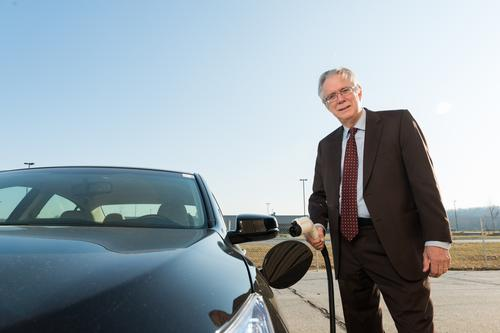 Willett Kempton of the University of Delaware has been a driving force behind the idea of vehicle-to-grid (V2G) technology. In 2013, Delaware teamed with NRG Energy to launch the world's first revenue-generating V2G project. Here, Kempton is shown with a Honda Accord Plug-In Hybrid that's being used as part of a demonstration project by the university.   (Source: Honda)