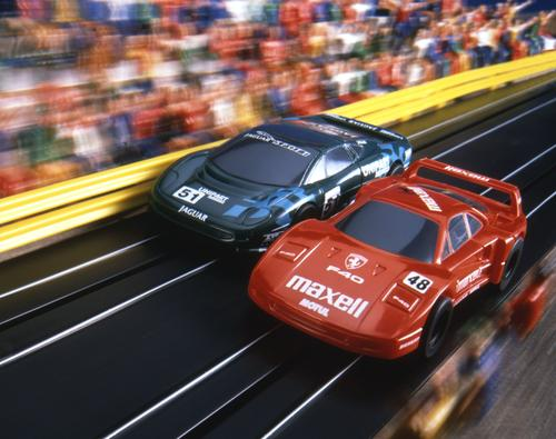 A slot car racing system from Scalextric pits a scale model of a 1995 Jaguar XJ220 against a Ferrari F40.   (Source: Scalextric)