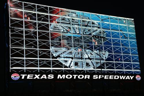 A massive graphic featuring animated construction workers shows that the Big Hoss TV screen can be operated as one big canvas, rather than as a conglomeration of separate squares. The scoreboard was unveiled March 19 at an event that drew 8,000 spectators to the Texas Motor Speedway.(Source: Panasonic ECO Solutions Co.)
