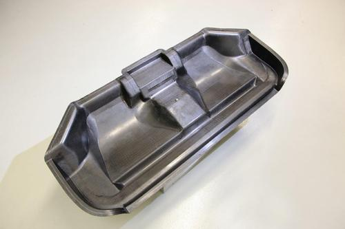 This rear seat base was produced via the resin transfer molding (RTM) process using Dow's commercial Voraforce 5300 epoxy carbon composite. The demonstration part, produced by Fehrer Automotive as part of Dow's Voraforce development program, is 60% carbon fiber by weight. In structural applications, one complex composite part can replace several pieces of steel welded together. The material's low viscosity, low moisture absorption, and cycle time of less than 90 seconds can make carbon composites used for such parts more price-competitive with steel in high volumes.(Source: Dow Automotive Systems)