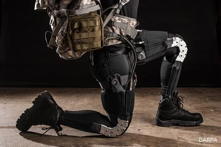 The Tactical Assault Light Operator Suit, or TALOS, being developed by the Department of Defense is being likened to the one worn by the lead character in 'Iron Man' for its qualities of near-invincibility. It can not only to monitor when a soldier has been injured, but also potentially heal a wound by applying treatment. The US Special Operations Unit, which is developing the suit, also is planning to include an exoskeleton framework with hydraulics around the joints to give soldiers extra movement, power, and strength beyond what they normally would have. A prototype of TALOS is expected in June, but this photo of the Defense Advanced Research Projects Agency's (DARPA) WHAT is a sneak peek of what the technology may look like.  (Source: DARPA)