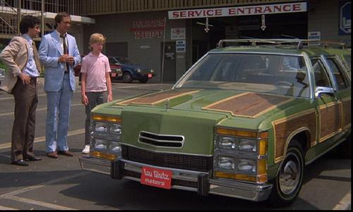 The 'Wagon Queen Family Truckster' in the 1983 movie National Lampoon's Vacation was actually a modified 1979 Ford LTD Country Squire station wagon. At one point in the film, the script called for the station wagon to go airborne, which it reportedly did for more than 50 feet. The hard landing damaged the front of the car, however, and the damage had to be exactly reproduced on other 'stand-in' vehicles for the rest of the film. During the scene in which the car was sold (shown here), the salesman tells the main character (Clark W. Griswold), 'You think you hate it now, wait 'til you drive it.'   (Source: Internet Movie Car Database)