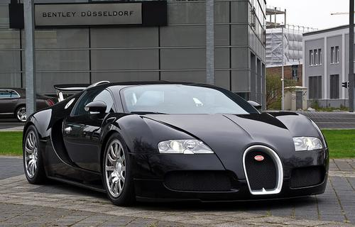 In the two-seater category, Bugatti's Veyron wins hands down. Often referred to as the 'fastest street-legal production car in the world,' the Veyron offers a top speed of 267 miles per hour. The turbocharged, 8.0-liter, 16-cylinder supercar cranks out an amazing 1,001 HP and earns a combined miles per gallon rating of 10 mpg. Its city rating is 8 mpg. On the highway, it gets 15 mpg, according to the US DOT.   (Source: Wikipedia)