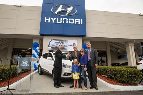 In a ceremony at a California dealership, Hyundai executives handed the keys to the first customer of the Tucson Fuel Cell CUV.   (Source: Hyundai Motor America)