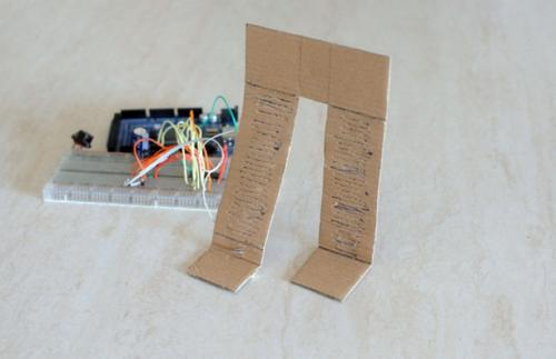 Marin Davide created a prototype of a moving biped using a shape memory alloy that works like a real muscle to move a cardboard leg.