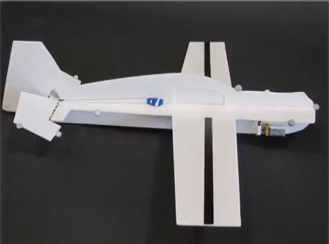 MIT researchers have developed a lightweight unmanned aerial vehicle (UAV) that can perch on a power line, paving the way for the possibility that the aircraft could recharge its batteries using power lines' magnetic fields.  (Source: MIT)