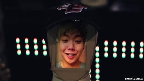 Superimposing a selfie on the screen-face of a Fanbot deployed by the Hanwha Eagles South Korean baseball team is one of the features of the robots, which inhabit a section of the team's home stadium  in Daejeon, South Korea, to cheer at games. The team has consistently been in last place in its league for five years and developed the robots to boost morale at the games, leading the human fans in cheers and keeping them engaged with activity at the stadium.   (Source: Hanwha Eagles)