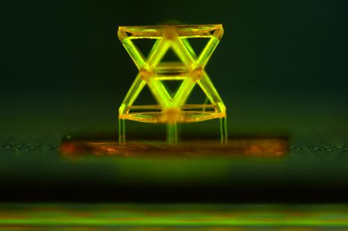This microscope image shows a single unit in the new micro-lattice super-lightweight, high-stiffness, high-strength metamaterial developed by Lawrence Livermore National Laboratory and MIT researchers. The stretch-dominated octet truss unit cell was made from a polymer using 3D projection micro-stereolithography, an additive manufacturing technique.