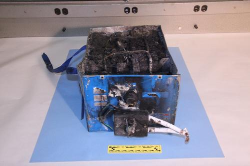 Auxiliary power batteries (shown here) caught fire on a Japan Airlines flight at Boston's Logan Airport in January 2013. The fire at Logan occurred nine days before the JAL fire that is now under investigation in Japan. Cold temperatures are reportedly being considered as a cause of the JAL fire.   (Source: NTSB)