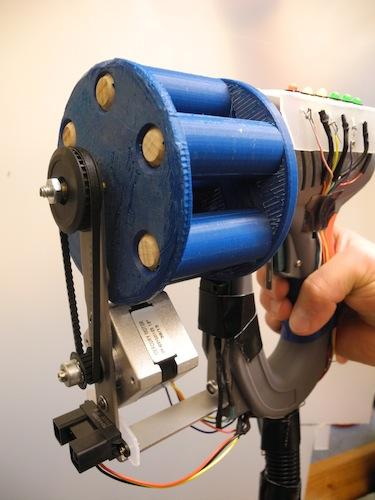 When the trigger is depressed, the high-speed solenoid inside the gun energizes a plunger that shoots the dart. The stepper motor then rotates to the next position and an LED on the top of the gun will turn off. There are a total of six shots available in one game round, and the game is over when all six shots have been fired.