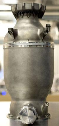 SpaceX has 3D printed and successfully hot-fired a SuperDraco engine chamber made of Inconel, a high-performance super alloy, using direct metal laser sintering (DMLS). The part was designed and built entirely in-house.   (Source: SpaceX)