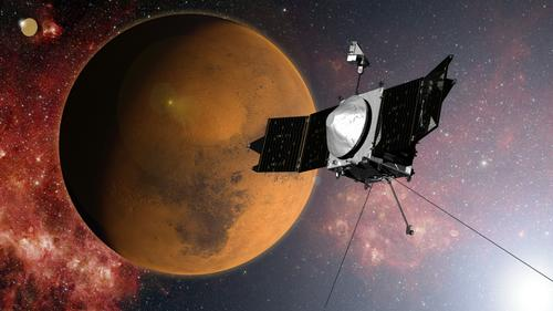 This artist's conception shows the MAVEN spacecraft as it enters Mars' orbit on September 21. Launched last November, the spacecraft is the first designed for exploring the structure and composition of Mars' upper atmosphere and ionosphere, and their interactions with the sun and solar wind. By determining today's rates of loss for both water and carbon dioxide, scientists hope to understand how losses of both water and carbon dioxide have impacted the planet's climate and habitability.