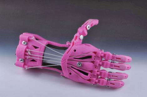 The so-called 'Cyborg Beast' is one of e-NABLE's most popular designs and was developed by Jorge Zuniga and his research group at Creighton University. It features textured fingertips for improved grip, Chicago screw joints, protected cable routing through the body of the palm, and an integrated tensioning system in the gauntlet.   (Source: Enabling the Future)