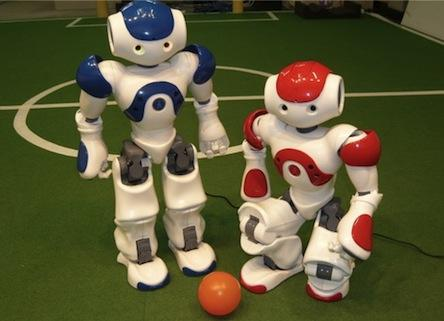 The classic case of robots playing sports is the RoboCup soccer World Cup, which has several different leagues. Teams participating in the Standard Platform League, where all teams use the same standard platform robot and focus on software development. The current platform is Aldebaran Robotics' Nao. This 22-inch-tall, friendly looking bot moves fluidly on its own with 25 degrees of freedom (DOF), avoids obstacles, responds to voice commands, and learns to recognize faces, voices, and shapes, among other talents. Aside from electric motors and actuators, it also has an extensive sensor network. This includes two cameras, four microphones, nine tactile sensors, eight pressure sensors, an inertial board, a sonar rangefinder, and two IR emitters and receivers. For communication it's equipped with two high-fidelity speakers, a voice synthesizer, and LED lights. Nao is fully programmable using software developed by Aldebaran. Other RoboCup leagues include different robot platforms classed by size. The ongoing RoboCup World Cup contest is aimed at developing a team of fully autonomous, cooperative, humanoid robots that can beat the best human soccer players -- and reach that goal by 2050. 