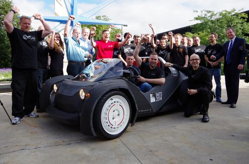 Local Motors made history by 3D printing an entire Strati EV on the show floor at Chicago's 2014 IMTS, assembling it, and driving it away in two days. The company is dedicated to distributed manufacturing, aided by crowdsourcing and a network of microfactories.