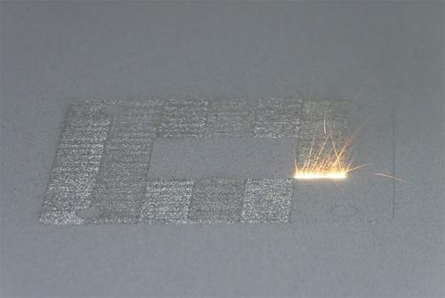 The National Institute of Standards and Technology (NIST) has issued a report about powder bed fusion measurement and process control needs. Shown here, a high-power laser spot scans back and forth over a layer of cobalt-chrome powder on NIST's powder bed fusion additive manufacturing machine. The laser travels so fast it appears to form a white-hot stripe about 10 mm wide.
