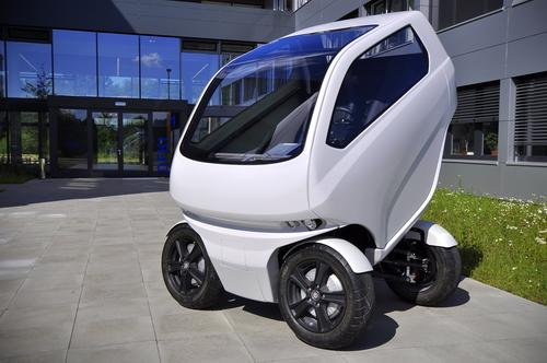 By tilting the cabin upward, the car loses 80 cm of its horizontal length. It can also turn its wheels perpendicular to the curb, so it can scoot sideways into a parking space.   (Source: DFKI GmbH Robotics Innovation Center)