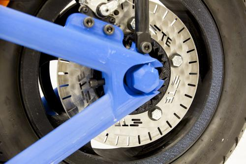 Almost all of the motorcycle's parts are 3D printed, even the wheel bearings. The only parts not 3D printed are the motor, drive belt, side mirrors, electronics, some bolts, battery, electronics, brake system, and kickstand.