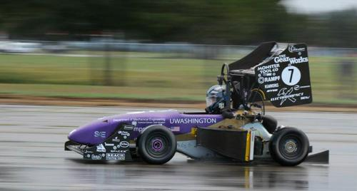 A student driver trains with the University of Washington Formula Motorsports Team 25 (2013-2014) combustion car in the rain.