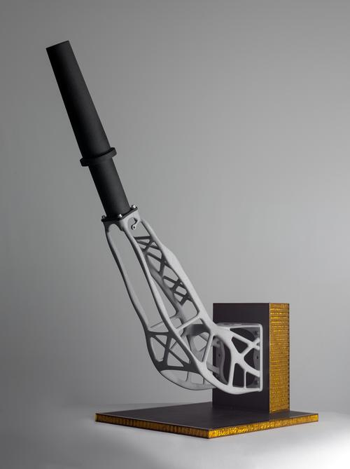 Structures designed for 3D printing that have been optimized for strength and light weight typically have more complex, organic shapes, like this 3D-printed aluminum satellite antenna support. It was designed and built by RUAG, partnering with Altair for optimization software and EOS for 3D printing.  The finished part is more rigid and weighs half as much as the previous one made via traditional manufacturing. 