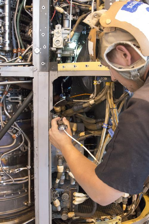 Aviation Mechanic prepares to install a 3D-printed titanium link and fitting on an MV-22 Osprey engine nacelle