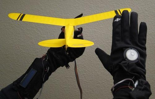 Using an accelerometer and a handful of sensors, a team of Colorado State University students created the Spatial Hand Remote. The gadget controls the flight of a remote control airplane through the sensors in a glove. The movement of the plane follows the movement of the glove. As the hand in the glove tilts to the right or left, so does the plane. Sensors attached to fingers are used to control the throttle, roll reverse, and the on-off switch. The user's hands control the plane like a maestro controlling an orchestra. Click here.   (Source: Design News)