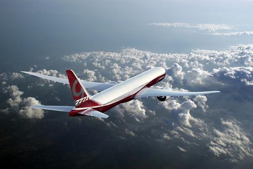Boeing's flagship 777X twin-engine passenger jet builds on the success of the company's 777 and 787 Dreamliner, but it will be even bigger. Its newly designed longer composite wings will maximize fuel efficiency. (Source: Boeing)