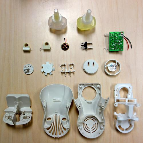 Disassembled plug-in air freshener. Photograph by Kevin Dooley.