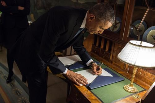 President Barack Obama signs two copies of the State of the Union address in the Diplomatic Reception Room prior to departing the White House en route to the Capitol to deliver the State of the Union address, Jan. 20, 2015. (Official White House Photo by Pete Souza)
