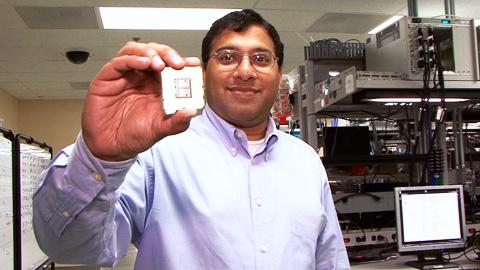 Ronak Singhal shows the Nehalem-class Xeon chip he helped design.