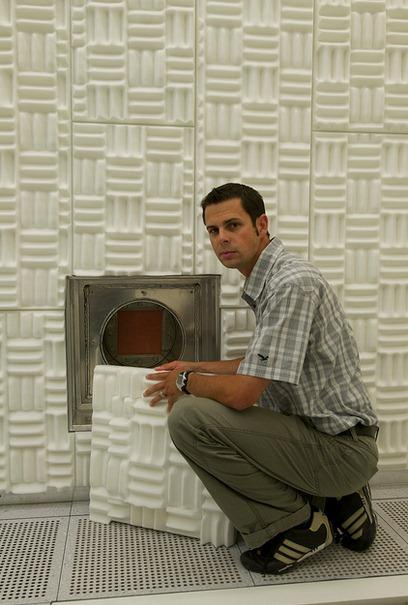 Emanuel Loertscher of IBM Zurich by the media feed-in port in his noise-free laboratory.