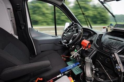 Ford's robotic driving system includes a ring gear attached to the steering wheel, a shifter actuator