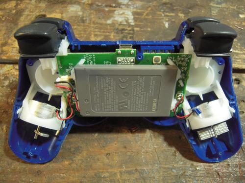 Here's the overall view of the inside of the controller. The triggers that need modification are located at the top of the image.
