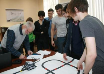 In association with Ford, students from the Telematics Department of St. Petersburg Polytechnic University and Professor Mikhail Kurochkin analyze model space rover movements.(Photo: Ford Motor Co.)