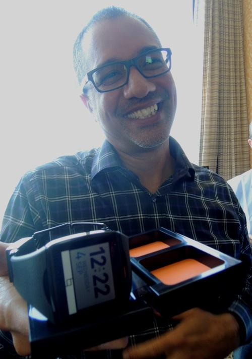 Rob Chandhook, who runs Qualcomm's AllJoyn program, showed the press Toq in its carrying case that doubles as a WiPower LE wireless charger for the watch and its stereo Bluetooth headsets.