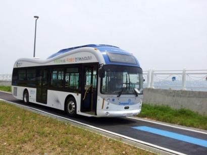 As they travel, these prototype buses (now in testing) recharge from coils buried in parts of the roadway.