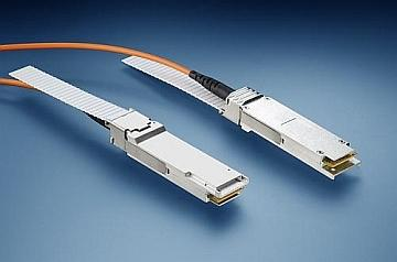 An active optical cable has optical/electrical converters at each end, such as these QSFP+ modules. (Source: Finisar)