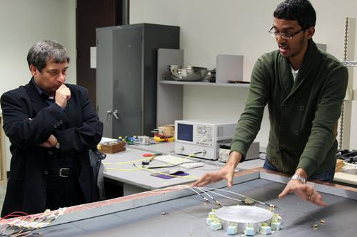 Professor George Eleftheriades (left) and doctoral candidate Michael Selvanayagam showing their new approach to invisibility cloaking. (Credit: Marit Mitchell) SOURCE: University of Toronto