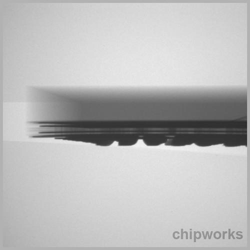 PS4's network coprocessor, X-Ray side view. (Source: Chipworks)