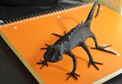A 3D print of 'Skitter Lizard' designed by the author using Blender.