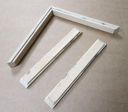 The pieces for the real frame, which provides a 1.25' gap between the full and half mirrors.