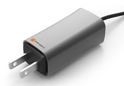 A miniature 65-W wall-plug laptop power adapter from startup FINsix uses very-high-speed switching to shrink its size to one fourth that of traditional adapters.