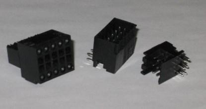 Figure 8. Samples of B2L and S2L double-decker plugs and sockets. The screwdriver is inserted into the rectangular slot on the socket on the left to release the spring clamp. The stripped wire is then inserted into the associated hole along the outer edge. (Click here to see a larger image.)
