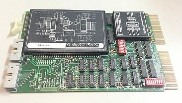 An early Data Translation product, the DT2762 data acquisition card for the QBus. Its acquisition hardware is built from discrete components housed in a module on the board.