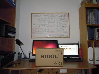 The newly arrived, boxed Rigol DS1052E oscilloscope sitting on my desktop.