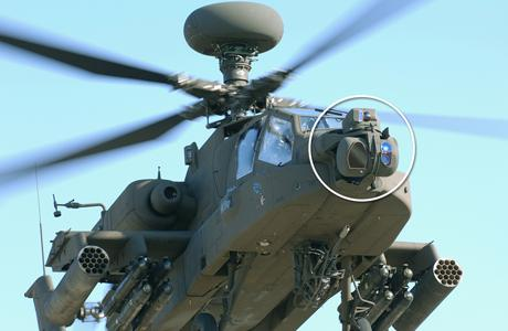 The Modernized Target Acquisition Designation Sight/Pilot Night Vision Sensor (M-TADS/PNVS) system from Lockheed Martin sits atop a helicopter.(Source: Lockheed Martin)